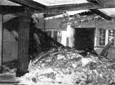 a falling chimney stack, having torn its way through roof and floors, lies scattered in its own debris at the foot of the oak staircase, and half fills the entrance hall