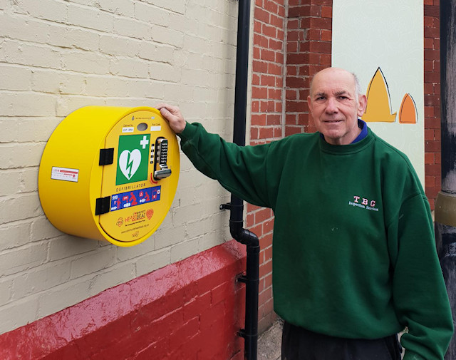 Electrician Mike Beese with the new Defibrillator