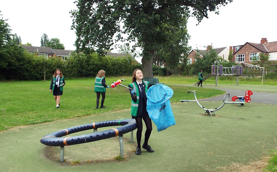 Students picking litter in Cromwell Avenue Park
